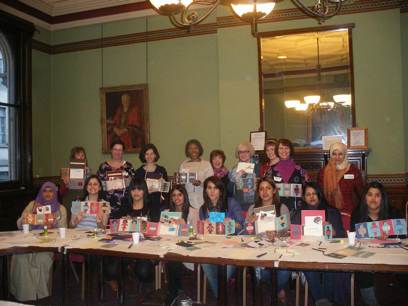 Photograph of participants at International Womens' Day showing their creations.