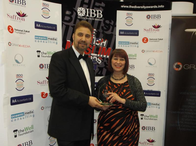 Afzal Khan and Heather Fletcher holding the award